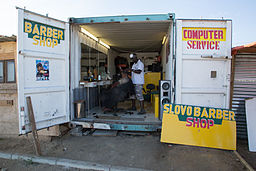 Barber Shop and Computer Service, Joe Slovo Park, Cape Town, South Africa (Source: Wiki media commons- Vgrigas)