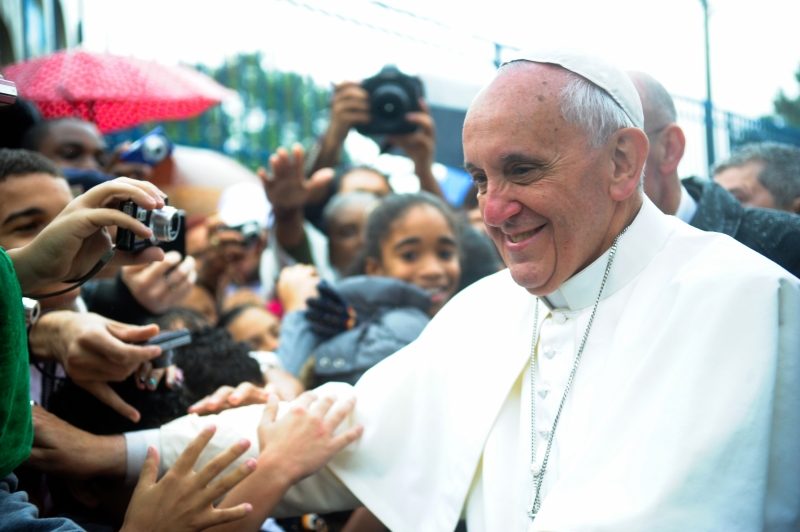 """Pope Francis at the Varginha shantytown, part of a slum area of northern Rio so violent it's known as the Gaza Strip. He has been dubbed the """"slum pope"""" for his work with the poor."""