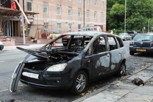 1024px-Liverpool_Riots_2011_damaged_car